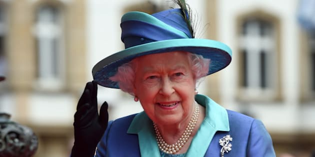 Britain's Queen Elizabeth II waves to the crowd on her way to the city hall in Frankfurt, central Germany, Thursday, June 25, 2015. Queen Elizabeth II and her husband Prince Philip are on an official visit to Germany until Friday, June 26. (Boris Roessler/Pool Photo via AP)