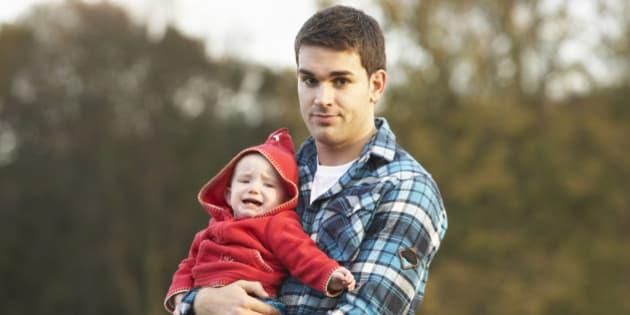 Shocked Teenage Boy Holding Baby