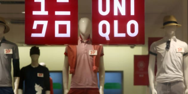 Signage for Uniqlo is displayed in a window of a store, operated by Fast Retailing Co., in Tokyo, Japan, on Wednesday, April 8, 2015. Fast Retailing, Asia's largest clothing retailer, is scheduled to announce earnings on April 9. Photographer: Tomohiro Ohsumi/Bloomberg via Getty Images