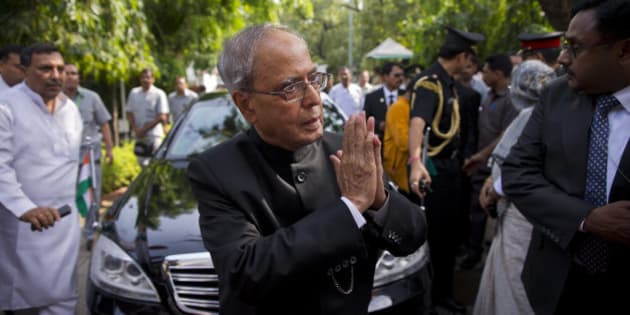 Indian President Pranab Mukherjee greets all well-wishers as he arrives to attend the funeral of his wife Suvra Mukherjee in New Delhi, India, Wednesday, Aug. 19, 2015. Suvra Mukherjee died Tuesday at age 74. (AP Photo/Saurabh Das, Pool)