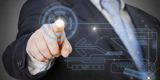 businessman pressing on modern technology