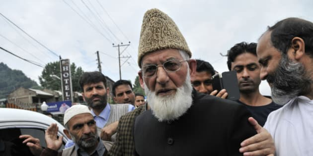SRINAGAR, INDIA - JUNE 5: Hurriyat Conference chairman Syed Ali Shah Geelani arrives at Regional passport office to fill passport details for travel documents on June 5, 2015 in Srinagar, India. Separatist leader Syed Ali Shah Geelani today appeared before passport authorities and declared himself as an Indian while completing formalities for travel documents but insisted that he did it out of compulsion. The Home and External Affairs ministries had a fortnight back said that Geelani's passport application was incomplete and could not be processed. (Photo by Waseem Andrabi/Hindustan Times via Getty Images)