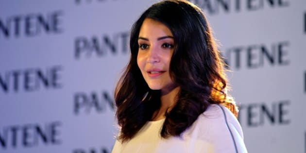Indian Bollywood actress Anushka Sharma appears as brand ambassador for Pantene's Bianca Hartkopf range in Mumbai late on July 29, 2015.   AFP PHOTO        (Photo credit should read STR/AFP/Getty Images)