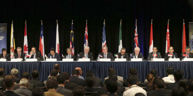 Ministers from 12 nations  from left,  Lim Jock Hoi from Brunei Darussalam, Ed Fast from Canada, Andres Rebolledo from Chile, Akira Amari from Japan, Sri Mustapa Mohamed of Malaysia, Andrew Robb from Australia, Mike Froman from the U.S., Ildefonso Guajardoform Mexico, Tim Groser from New Zealand, Jorge Del Castillo from Peru, Lim Hng Kiang from Singapore and Tran Quoc Khanh from Vietnam attend a press conference at the Trans-Pacific Partnership meeting in Sydney, Australia, Monday, Oct. 27, 2014. (AP Photo/Rob Griffith)