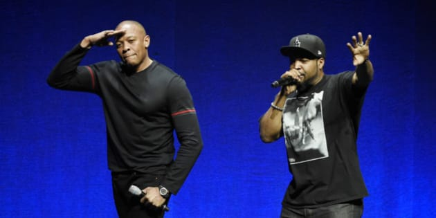 "N.W.A. members Dr. Dre, left, and Ice Cube, two of the subjects of the upcoming biographical drama ""Straight Outta Compton,"" salute the crowd after speaking at the Universal Pictures presentation during CinemaCon 2015 at Caesars Palace on Thursday, April 23, 2015, in Las Vegas. (Photo by Chris Pizzello/Invision/AP)"
