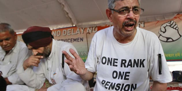 NEW DELHI, INDIA - AUGUST 17: Col (Retd.) Pushpender Singh (R) and Hav. (Retd.) Major Singh (2R) on indefinite hunger strike with others at Jantar Mantar on August 17, 2015 in New Delhi, India. Cranking up pressure on the government to implement 'One Rank, One Pension' (OROP) scheme, 10 former Service Chiefs have written to the Prime Minister pressing for its expeditious resolution even as two ex-Army men began an indefinite hunger fast at Jantar Mantar. (Photo by Sanjeev Verma/Hindustan Times via Getty Images)