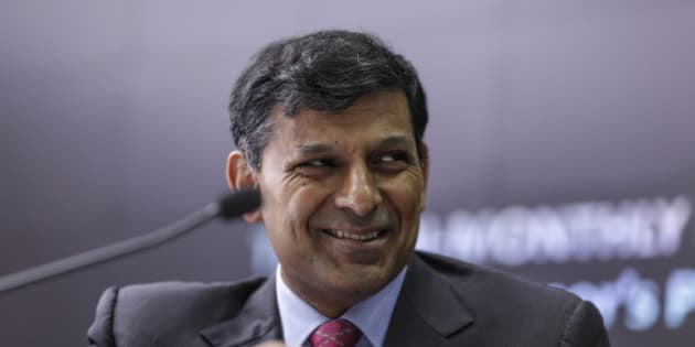 Raghuram Rajan, governor of the Reserve Bank of India (RBI), smiles during a news conference in Mumbai, India, on Tuesday, Aug 4, 2015. Rajan kept interest rates unchanged, rebuffing pressure from the Finance Ministry to reduce borrowing costs that are among the highest in Asia. Photographer: Dhiraj Singh/Bloomberg via Getty Images