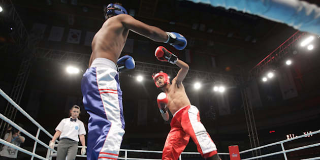 INCHEON, SOUTH KOREA - JULY 03:  Thanh Tran (Red) of Vietnam compete with Kumar Visal (Blue) of India in the Kickboxing, Full Contact Men's 71kg Round of 16 at Dowon Gymnasium during day five of the 4th Asian Indoor Martial Arts Games on July 3, 2013 in Incheon, South Korea.  (Photo by Chung Sung-Jun/Getty Images)