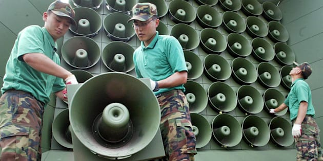 South Korean soldiers remove loudspeakers used for propaganda near the demilitarized zone between South and North Korea, in Paju city, north of Seoul, Wednesday, June 16, 2004. North and South Korea have ended propaganda broadcasts over loudspeakers along their heavily militarized border as part of efforts to reduce tension on their divided peninsula. (AP Photo/ Lee Jin-man)