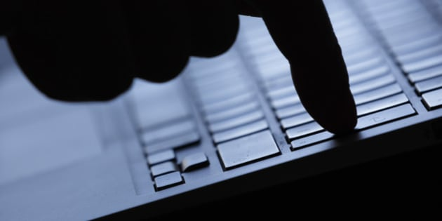 BERLIN, GERMANY - AUGUST 20: Symbolic feature with topic online crime, data theft and piracy, here a finger on the keyboard of a computer, on Augut 20, 2015 in Berlin, Germany. (Photo by Thomas Trutschel/Photothek via Getty Images)