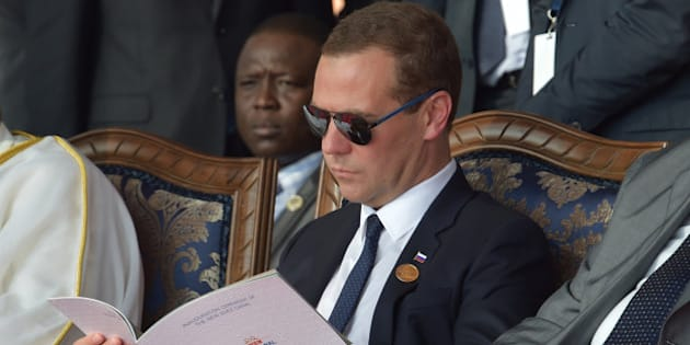 Russian Prime Minister Dmitry Medvedev, reads a program during the opening ceremony of the new section of the Suez Canal in Ismailia, Egypt, Thursday, Aug. 6, 2015. With much pomp and fanfare, Egypt on Thursday unveiled a major extension of the Suez Canal whose patron, President Abdel-Fattah el-Sissi, has billed as an historic achievement needed to boost the country's ailing economy after years of unrest.  (Alexander Astafyev/RIA Novosti, Government Press Service Pool Photo via AP)