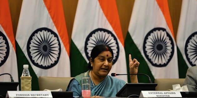 Indian Foreign Affairs Minister Sushma Swaraj gestures during a press conference in New Delhi on August 22, 2015.  India issued an ultimatum to Pakistan on August 22, giving Islamabad until midnight to agree to restrict high-level bilateral talks to militancy alone, leaving a planned meeting between the two countries' national security advisers in doubt. AFP PHOTO / Chandan KHANNA        (Photo credit should read Chandan Khanna/AFP/Getty Images)