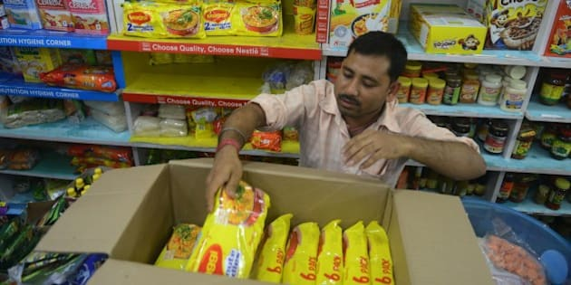 An Indian shopkeeper removes packets of Nestle 'Maggi' instant noodles from the shelves in his shop in Siliguri on June 5, 2015. India's food safety regulator on June 5 banned the sale and production of Nestle's Maggi instant noodles over a health scare after tests found they contained excessive lead levels. AFP PHOTO/Diptendu DUTTA        (Photo credit should read DIPTENDU DUTTA/AFP/Getty Images)