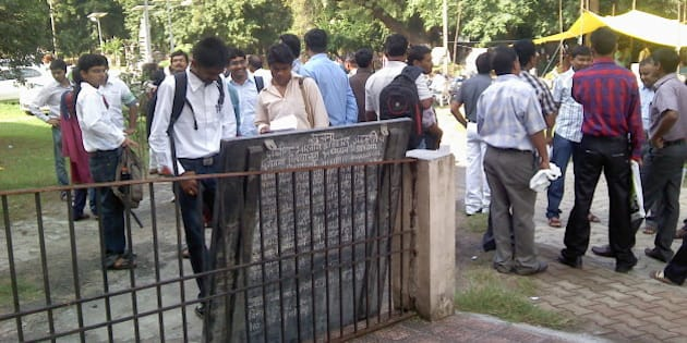Candidates checking their roll numbers on the first day of MPSC State Services Main Examination 2012 at Vasantrao Naik Institute of Arts and Social Sciences (Morris College), Nagpur.