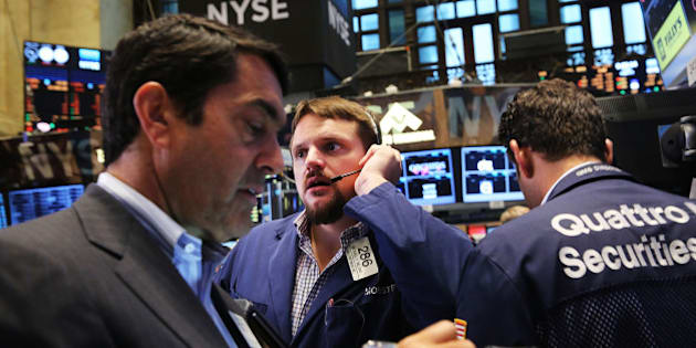 NEW YORK, NY - AUGUST 21:  Traders work on the floor of the New York Stock Exchange (NYSE) on August 21, 2015 in New York City. The Dow fell over 150 points in morning trading as global markets continue to react to economic events in China.  (Photo by Spencer Platt/Getty Images)