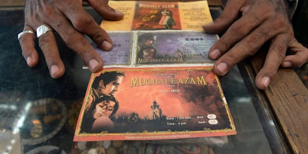 Indian cinema memorabilia dealer Shahid Mansoori displays a print of original movie theatre tickets of epic Indian film Mughal-E-Azam (Mughal Emperor of Emperors) from the black and white version (top and the digitised colour version (centre and bottom) in his shop 'Mini Market' in Mumbai on April 30, 2013. One hundred years after the screening of a black-and-white silent film, India's brash, song-and-dance-laden Bollywood film industry celebrates its centenary later this week. The milestone will be marked with little fanfare, while India will be honoured as 'guest country' at next month's Cannes festival.   AFP PHOTO/ INDRANIL MUKHERJEE        (Photo credit should read INDRANIL MUKHERJEE/AFP/Getty Images)