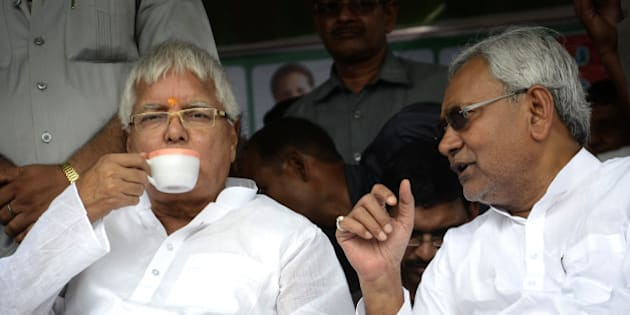 HAJIPUR, INDIA - AUGUST 11: RJD chief Lalu Prasad and JD (U) senior leader Nitish Kumar at a by-election rally at on August 11, 2014 in Hajipur, India. This was first time after two decades that the two leaders shared a dias.   The joint rally of Lalu and Nitish kicked off the byelection campaign of secular alliance of RJD, JD(U) and Congress for 10 assembly seats of Bihar that would go to vote on August 21. (Photo by Santosh Kumar/Hindustan Times via Getty Images)