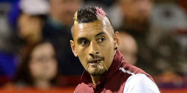 MONTREAL, ON - AUGUST 12:  Nick Kyrgios of Australia looks on as he bites onto his chain against Stan Wawrinka of Switzerland during day three of the Rogers Cup at Uniprix Stadium on August 12, 2015 in Montreal, Quebec, Canada.  (Photo by Minas Panagiotakis/Getty Images)