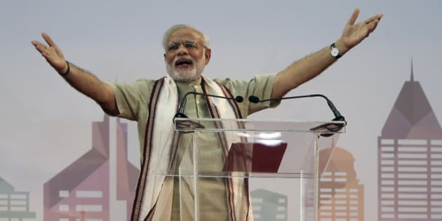 Indian Prime Minister Narendra Modi addresses Indian expatriates at a cricket stadium, Monday, Aug. 17, 2015, in Dubai, United Arab Emirates. The UAE is home to over two million Indian expatriates and this is the first visit by an Indian premier in over three decades. (AP Photo/Kamran Jebreili)