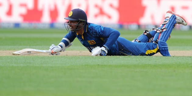 Sri Lanka's Kumar Sangakkara  dives to make his ground against Engalnd during their Cricket World Cup match in Wellington, New Zealand, Sunday, March 1, 2015. (AP Photo Ross Setford)