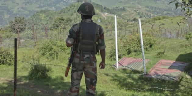 An Indian army soldier guards near fencing on the line of control near Balakot sector in Poonch, Jammu and Kashmir, India, Monday, Aug.17, 2015. Despite a 2003 cease-fire, the two neighbors regularly trade fire, the latest coming as India celebrated Independence Day on Saturday. Pakistan observed it a day earlier. (AP Photo/Channi Anand)
