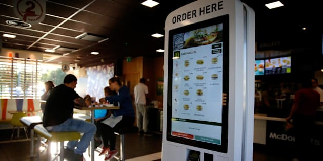 A self-service card payment touch screen panel displays sandwich options inside a McDonald's Corp. restaurant in Manchester, U.K., on Monday, Aug. 10, 2015. McDonald's Chief Executive Officer Steve Easterbrook predicted a return to growth for the burger chain in the second half of the year, giving investors cause for optimism after another quarter of slumping sales. Photographer: Paul Thomas/Bloomberg via Getty Images