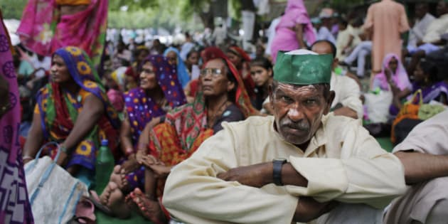 An Indian farmer attends a gathering near the Indian parliament for a protest against the Land Acquisition Bill in New Delhi, India, Friday, July 24, 2015. Indian farmers protested against the ruling Bharatiya Janata Party (BJP) demanding the withdrawal of the controversial Land Acquisition Bill, calling it anti-farmer in a country where agriculture is the main livelihood for more than 60 percent of the 1.2 billion people.(AP Photo/Altaf Qadri)