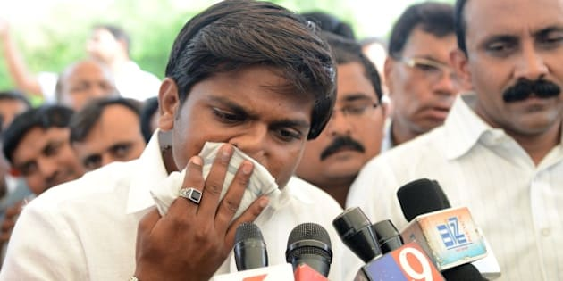 Hardik Patel (C), an organiser of the Patidar community, gathers with group members for a rally demanding 'Other Backward Class' (OBC) status in Ahmedabad on August 23, 2015. OBC members have urged the Gujarat government not to grant the Patel, or Patidar, community the status, which grants official protection of the members' social and educational development. AFP PHOTO / Sam PANTHAKY        (Photo credit should read SAM PANTHAKY/AFP/Getty Images)