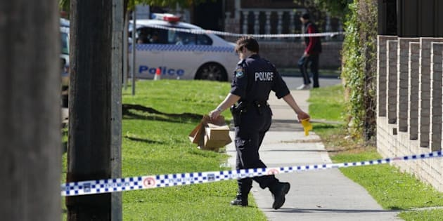 (AUSTRALIA & NEW ZEALAND OUT) Police gather evidence from a block of units in Cairds Avenue in Bankstown, Sydney, the morning after a siege in which a policemen, Bill Crews, was fatally shot in the head and neck. (Photo by Fairfax Media via Getty Images)