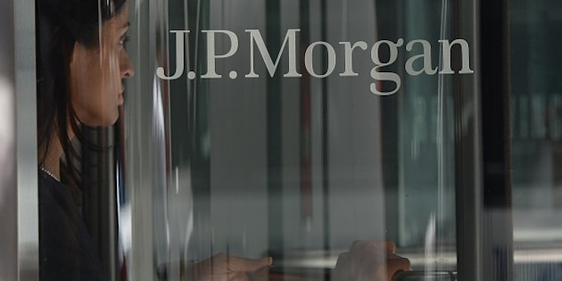 A woman leaves JP Morgan Chase & Company headquarters in New York, August 14, 2013. The US August 14, 2013 charged a pair of former JPMorgan Chase traders with fraud in connection with the 2012 $6.2 billion 'London whale' trading losses. Federal prosecutors filed criminal charges against Javier Martin-Artajo and Julien Grout, alleging the two men kept false records on the trades, committed wire fraud and submitted false US securities filings.   AFP PHOTO/Emmanuel Dunand        (Photo credit should read EMMANUEL DUNAND/AFP/Getty Images)