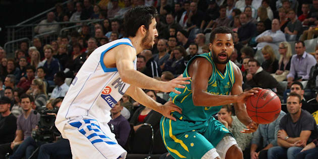 MELBOURNE, AUSTRALIA - JUNE 24:  Patty Mills of Australia is pressured by his opponent during the first match between the Australian Boomers and Greece at Hisense Arena on June 24, 2012 in Melbourne, Australia.  (Photo by Robert Cianflone/Getty Images)