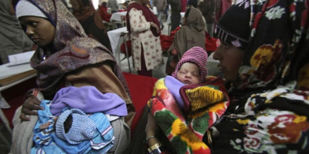 Indian mothers hold their babies, born on 12/12/12 at a hospital in Jammu, India, Wednesday, Dec. 12, 2012. The date 12/12/12, seen as auspicious by astrologers, saw an influx of mothers to local hospitals looking to give birth on the date which won't happen again for nearly 100 years, local media reported. (AP Photo/Channi Anand)