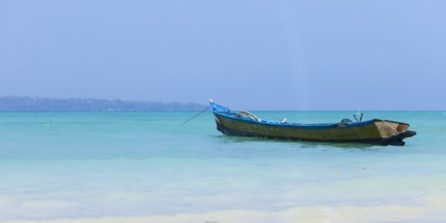 Traditional longtail boat on tropical Havelock island, Andaman Islands, India