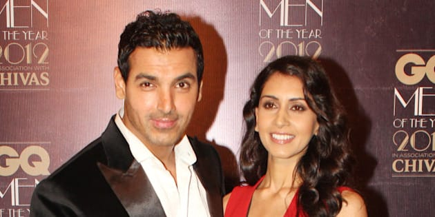 MUMBAI, INDIA - SEPTEMBER 30: Indian Bollywood actor John Abraham with girlfriend Priya Runchal during the GQ Men of the Year Awards 2012 ceremony in Mumbai on September 30, 2012. (Photo by Yogen Shah/India Today Group/Getty Images)