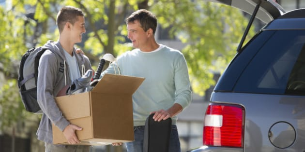USA, New Jersey, Jersey City, Father helping teenage son (16-17) packing to college