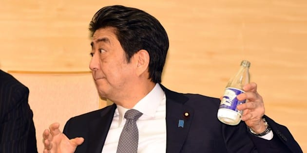 Japan's Prime Minister Shinzo Abe pours water into a glass while looking at visiting South African Deputy President Cyril Ramaphosa (not pictured) during their meeting at Abe's official residence in Tokyo on August 24, 2015.  Ramaphosa arrived here on August 22 for a four-day working visit.        AFP PHOTO / POOL / TOSHIFUMI KITAMURA        (Photo credit should read TOSHIFUMI KITAMURA/AFP/Getty Images)