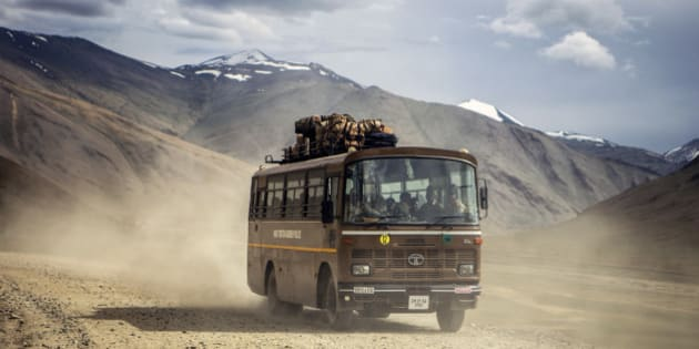 A bus travels along the Leh Manali highway in Ladakh region, Jammu and Kashmir, India, on Saturday, Aug. 8, 2015. India is scheduled to release second-quarter gross domestic product figures on Aug. 31. Photographer: Prashanth Vishwanathan/Bloomberg via Getty Images