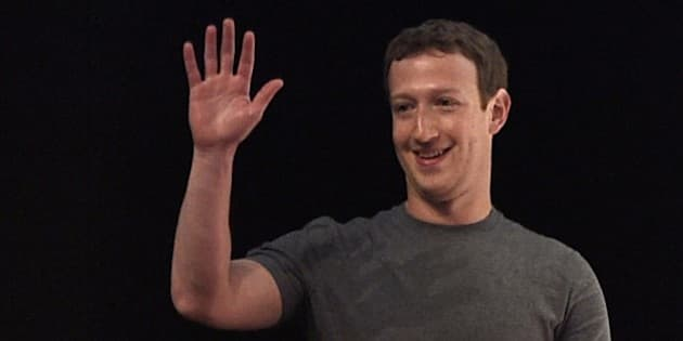 Facebook's creator US Mark Zuckerberg waves before speaking on the opening day of the 2015 Mobile World Congress (MWC) in Barcelona on March 2, 2015. Phone makers will seek to seduce new buyers with even smarter Internet-connected watches and other wireless gadgets as they wrestle for dominance at the world's biggest mobile fair starting today. AFP PHOTO / LLUIS GENE        (Photo credit should read LLUIS GENE/AFP/Getty Images)