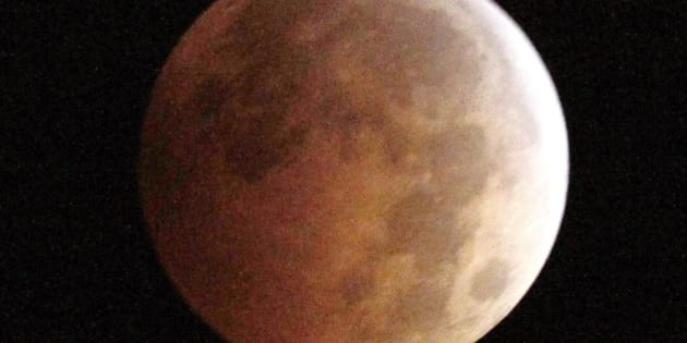 The Blood Moon, created by the full moon passing into the shadow of the earth during  a total lunar eclipse, as seen from Monterey Park, Ca., on Wednesday morning, Oct. 8,  2014.  (AP Photo/ Nick Ut )
