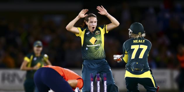 HOVE, ENGLAND - AUGUST 28:  Megan Schutt of Australia celebrates with Alyssa Healy of Australia after bowling out Katherine Brunt of England during the 2nd NatWest T20 of the Women's Ashes Series between England and Australia Women at BrightonandHoveJobs.com County Ground on August 28, 2015 in Hove, United Kingdom.  (Photo by Jordan Mansfield/Getty Images)