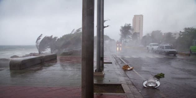 Broken traffic lights and street lamps lay on the ground as the strong winds of Tropical Storm Erika approach Santo Domingo, in the Dominican Republic, Friday, August 28, 2015. Tropical Storm Erika began to lose steam Friday over the Dominican Republic, but it left behind a trail of destruction that included several people killed on the small eastern Caribbean island of Dominica, authorities said. (AP Photo/Tatiana Fernandez)