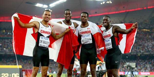 BEIJING, CHINA - AUGUST 29:  Aaron Brown of Canada, Andre De Grasse of Canada, Brendon Rodney of Canada and Justyn Warner of Canada celebrate after winning bronze in the Men's 4x100 Metres Relay final during day eight of the 15th IAAF World Athletics Championships Beijing 2015 at Beijing National Stadium on August 29, 2015 in Beijing, China.  (Photo by Ian Walton/Getty Images)