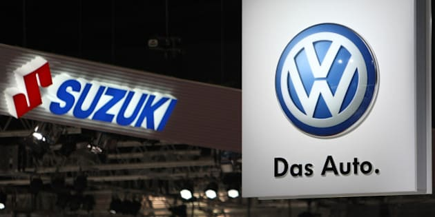 Suzuki Motor Corp., left, and Volkswagen AG (VW) logos are displayed at the Tokyo Motor Show 2011 in Tokyo, Japan, on Wednesday, Nov. 30, 2011. Japanese automakers compete for a dwindling number of local buyers at the show as the domestic market fails to provide a haven from a strong yen that's eroding profits from overseas sales. Photographer: Tomohiro Ohsumi/Bloomberg via Getty Images