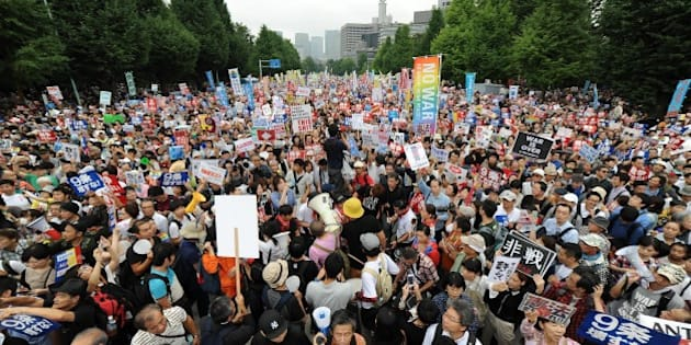 TOKYO, JAPAN - AUGUST 30 : People take part a major protest labeled as a nationwide movement for 1 million people organized near the National Diet Building  on August 30, 2015, in Tokyo, Japan to voice opposition to security-related bills and Japan Prime Minister Shinzo abe's administration security policy. (Photo by David MAREUIL/Anadolu Agency/Getty Images)