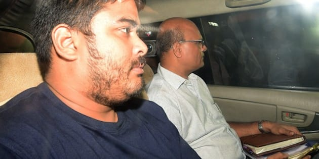 Mikhail Bora, the son of former Indian media executive Indrani Mukherjea, leaves a police station in Mumbai on August 28, 2015. A former Indian media executive has been arrested on suspicion of murdering her daughter for having an affair with her stepson, Mumbai police said August 27, in a case gripping India. Indrani Mukerjea is accused, along with two others, of strangling Sheena Bora to death in 2012 before dumping her body in a forest in western Maharashtra state and setting it alight. AFP PHOTO        (Photo credit should read STR/AFP/Getty Images)
