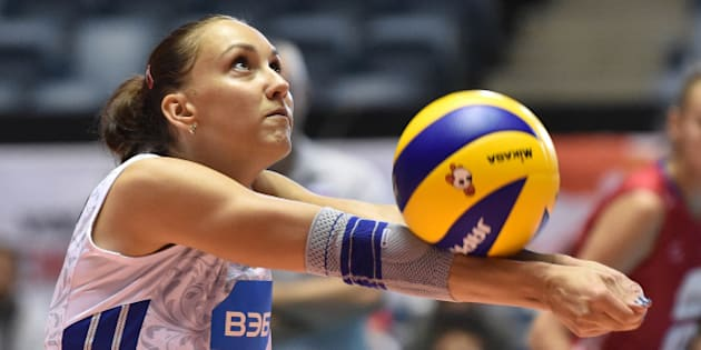 TOKYO, JAPAN - AUGUST 26:  Victoria Kuzyakina of Russia receives in the match between Argentina and Russia during the FIVB Women's Volleyball World Cup Japan 2015 at Yoyogi National Stadium on August 26, 2015 in Tokyo, Japan.  (Photo by Atsushi Tomura/Getty Images for FIVB)