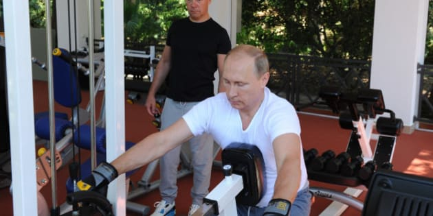 Russian President Vladimir Putin, foreground, and Prime Minister Dmitry Medvedev exercise during their meeting at the Black Sea resort of Sochi, Russia, Sunday, Aug. 30, 2015. (AP Photo/RIA Novosti, Mikhail Klimentyev, Presidential Press Service)