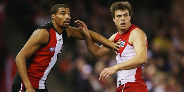 MELBOURNE, AUSTRALIA - AUGUST 30:  Jason Holmes (L) of the Saints calls for the ball next to Mike Pyke of the Swans during the round 22 AFL match between the St Kilda Saints and the Sydney Swans at Etihad Stadium on August 30, 2015 in Melbourne, Australia.  (Photo by Michael Dodge/Getty Images)