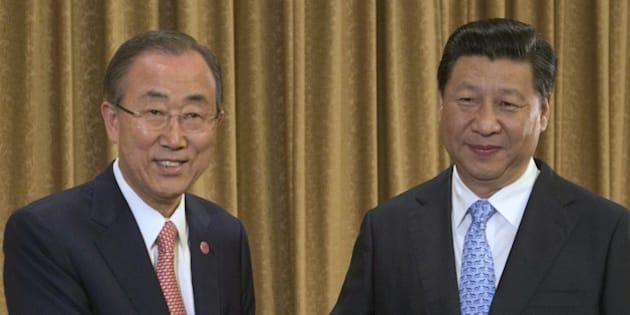 UN Secretary-General Ban Ki-moon (L) and Chinese President Xi Jinping (R) face the media during a ceremonial handshake before starting a meeting at the Purple Palace in Nanjing on August 16 2014. The two officials met before their expected attendance at the opening ceremonies of the Nanjing 2014 Youth Olympic Games, scheduled for the evening of August 16.   AFP PHOTO / POOL / ROLEX DELA PENA        (Photo credit should read ROLEX DELA PENA/AFP/Getty Images)