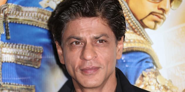 Actor Shah Rukh Khan poses for photographers during a photo call for the film, Happy New Year-SLAM, at the Montcalm hotel in central London, Sunday, Oct. 5, 2014. (Photo by Joel Ryan/Invision/AP)
